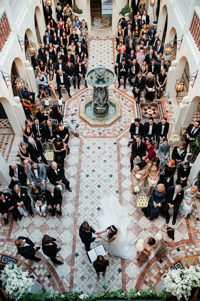Wedding ceremony in the courtyard of Versace Mansion Photo by Jan Freire
